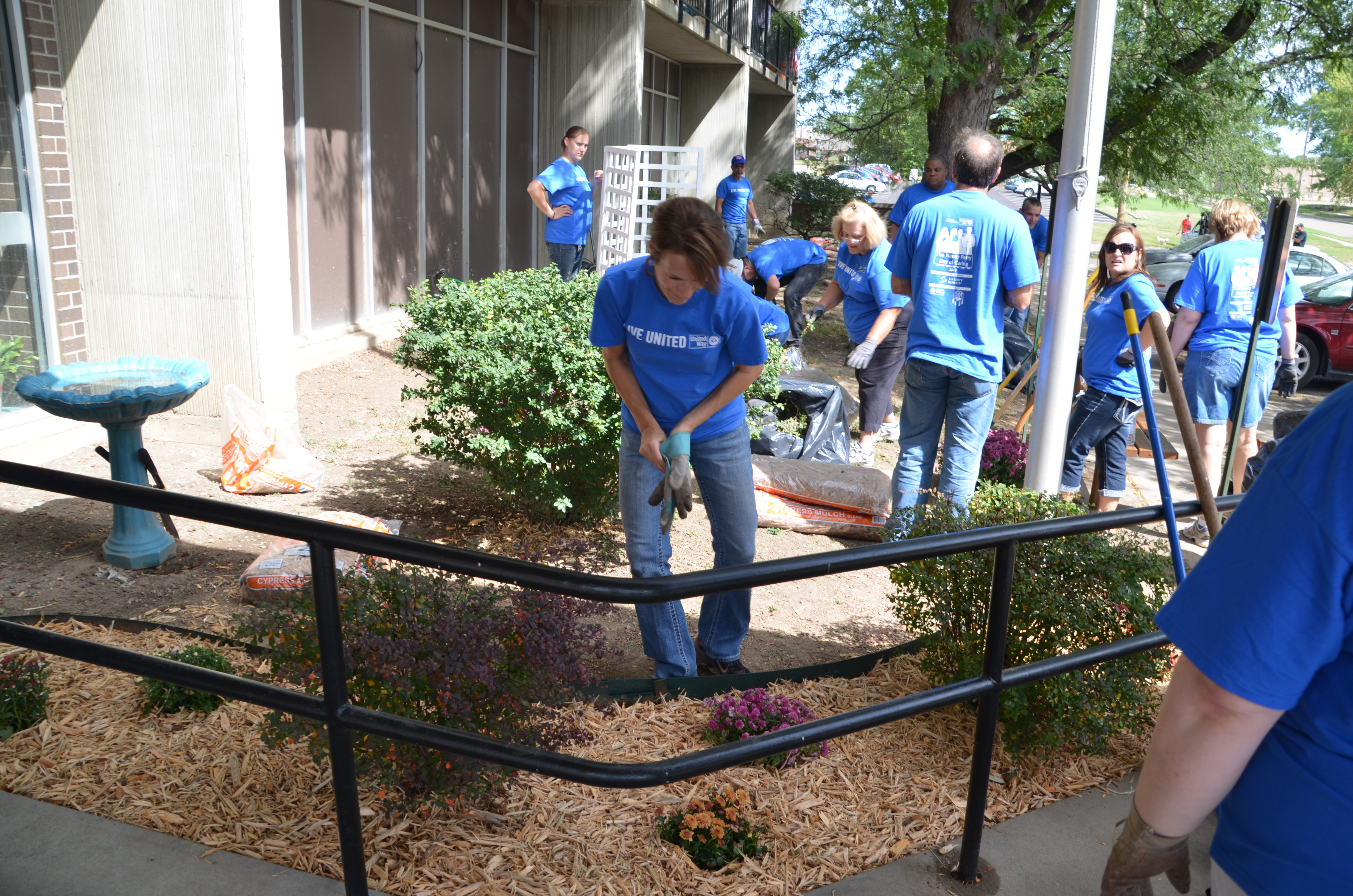 Capitol Federal employees landscaped and planted shrubs and